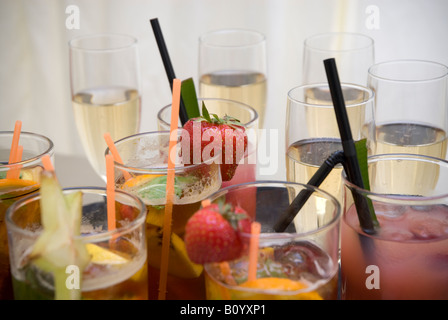 Glasses of Pimms and champange with strawberrys - Stock Photo