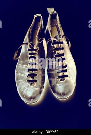 Photo-illustration of Vintage football boots - Stock Photo