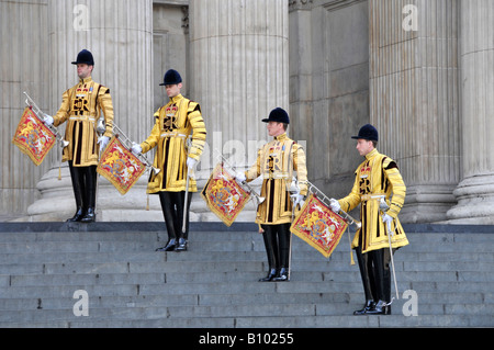 Life Guards trumpeter in uniform wait on steps of St Pauls Cathedral to play trumpets fanfare for arrival of Prince - Stock Photo