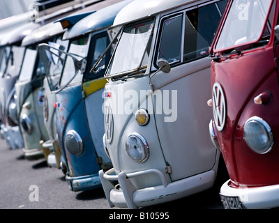 line up of vw volkswagen split screen bus camper vans - Stock Photo