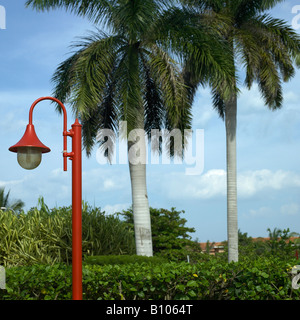red lamp post in tropical street - Stock Photo