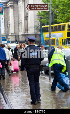 Young Garda Officer Dublin Ireland - Stock Photo
