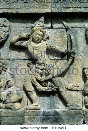 Borobodur Java 850 AD Buddha Shiva with bow and arrow Carving  Copyright A Eaton AAA Collection - Stock Photo