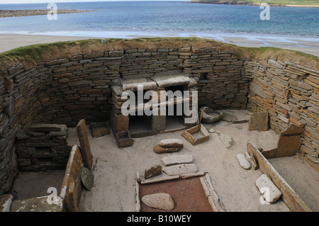 Skara Brae on Orkney Island in Scotland is a Neolithic settlement by the Bay of Skaill. - Stock Photo