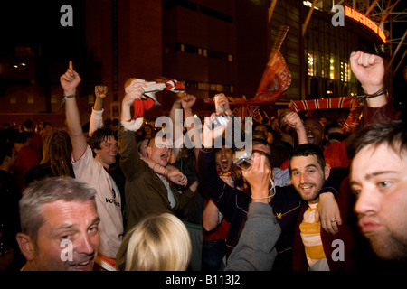 MANCHESTER MAY 21, 2008 Manchester United fans celebrate outside Old Trafford after their team won the UEFA Champions - Stock Photo