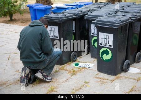 Several, many, stack of plastic metal recycling wheelie bins in Malta. - Stock Photo