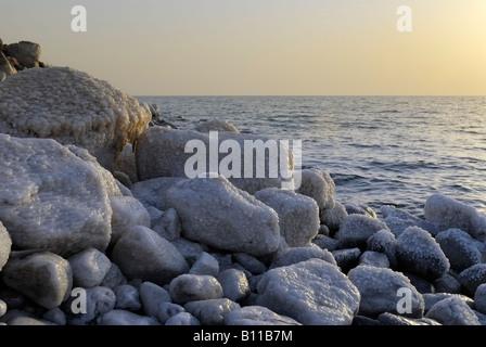 rocks with salt at coastline of Dead Sea Jordan Arabia, lowest place on earth Stock Photo