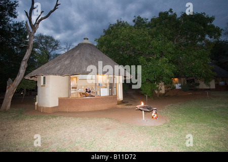Rondavel styled bungalow at Satara rest camp with self catering brai (BBQ) facility in Kruger NP, South Africa. - Stock Photo