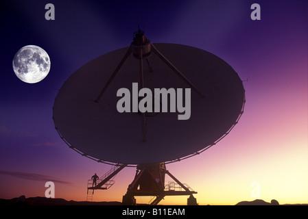 MAN STANDING ON SINGLE SATELLITE DISH JANSKY VLART RADIO TELESCOPE ARRAY PLAINS OF SAINT AUGUSTINE NEW MEXICO USA - Stock Photo