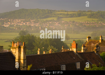 Batheaston Bath BaNES England UK Sunrise over chimney pots looking towards Bathampton water meadows - Stock Photo
