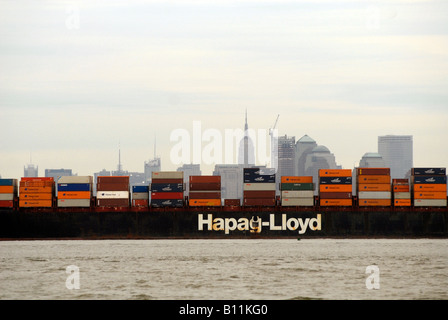 The Essen Express of the Hapag Lloyd line leaves port on the Hudson River North River in New Jersey laden with containers - Stock Photo
