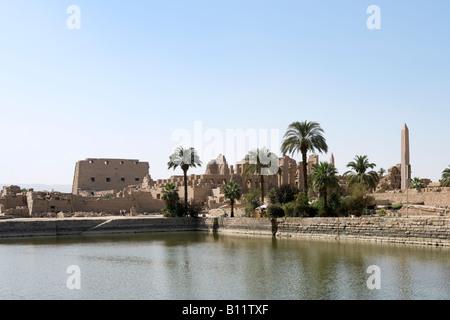 Precinct of Amun from across the Sacred Lake, Temple of Karnak, Luxor, Nile Valley, Egypt - Stock Photo