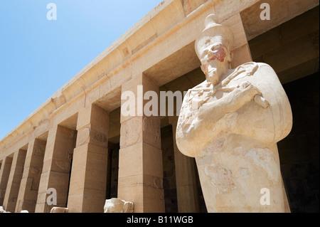 Statue of Osiris on Upper Terrace, Deir el Bahri or Mortuary Temple of Queen Hatshepsut, West Bank, Luxor, Nile - Stock Photo