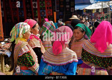 Flower Hmong women Bac Ha Sunday Market Northern Vietnam - Stock Photo