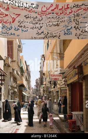 Typical Street and Shops near the bazaar, Sharia al Souk, Luxor, Nile Valley, Egypt - Stock Photo