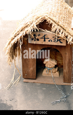 Wooden statue of a dog in Otaru Hokkaido Japan - Stock Photo