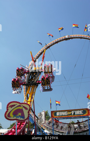 G Force and Ring Of Fire Carnival Rides Canfield Fair Canfield Ohio - Stock Photo