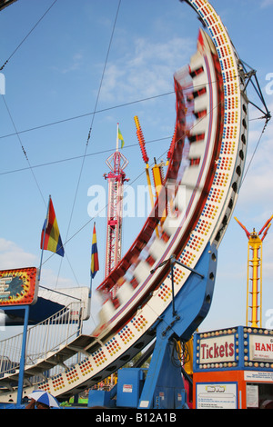 Ring Of Fire Carnival Ride with Motion Blur Canfield Fair Canfield Ohio - Stock Photo