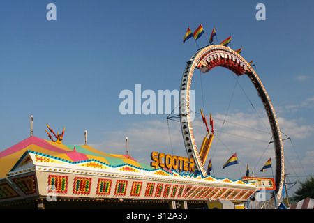 Carnival Rides named Scooter or Bumper Cars and Ring Of Fire beyond Canfield Fair Canfield Ohio - Stock Photo