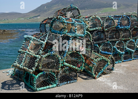 Lobster pots on harbour side. Achill Island, County Mayo, Ireland - Stock Photo