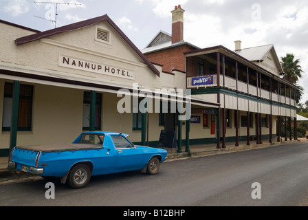 An old blue Holden utility parked outside a traditional country town pub, Nannup, Western Australia - Stock Photo