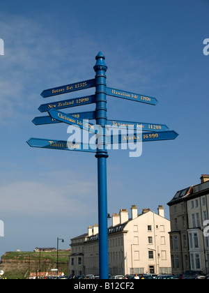 A signpost in Whitby showing distances sailed in Nautical Miles to places discovered by the famous navigator Captain - Stock Photo