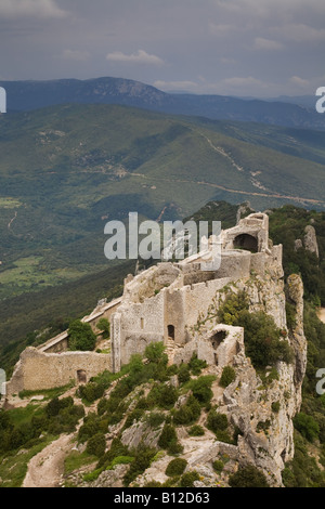 The ruins and ruined fortress of the Chateau de Peyrepertuse in Languedoc Roussillon Southern France - Stock Photo