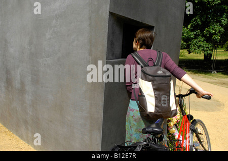 Berlin memorial to gay victims of nazis woman female bike bicycle - Stock Photo