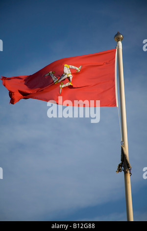 Isle of Man Flag, red with blue sky,flying on flagpole. vertical, 83111_IOM Flag - Stock Photo