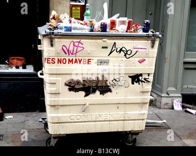 Rubbish placed on top of bin in London street - Stock Photo