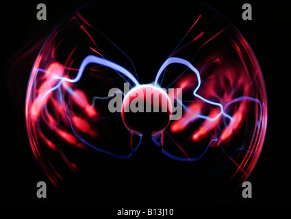 Plasma Ball with illuminated hands. Plasma lamps come in spheres and cylinders. plasma lamp is usually a clear glass - Stock Photo