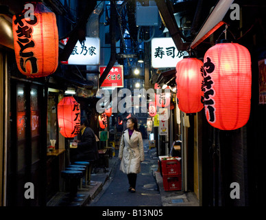 Narrow alley with red lanterns at Shomben Yokocho area full of bars and restaurants in Shinjuku Tokyo Japan - Stock Photo
