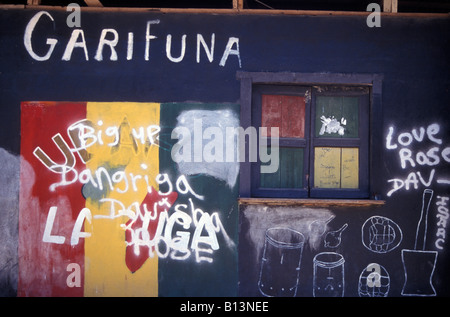 Garifuna graffiti on a wall in the Garifuna town of Livingston on the Caribbean coast of Guatemala - Stock Photo