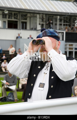Man with Binoculars MR, horse racing, spectator, lens, look, person searching, surveillance binocular at Perth Racecourse, - Stock Photo