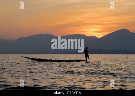 sunset on the Inle lake boat in front,  MYANMAR BURMA BIRMA, ASIA - Stock Photo