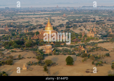 Ballons ride over Bagan golden dome of DHAMMA YA ZA KA ZEDI, BAGAN PAGAN, MYANMAR BURMA BIRMA, ASIA - Stock Photo