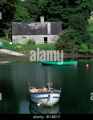 derrynane, iveragh peninsula, county ring of kerry, boats reflected in the still waters of a west of ireland sheltered - Stock Photo