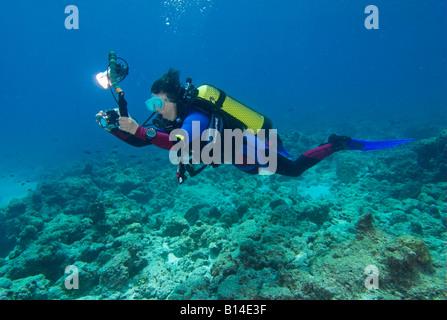 Woman scuba diver with compact underwater camera Bangaram Island Lakshadweep Arabian Sea India - Stock Photo
