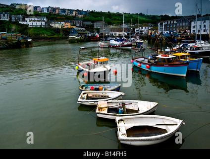 Boats in Mevagissey harbour in Cornwall. - Stock Photo