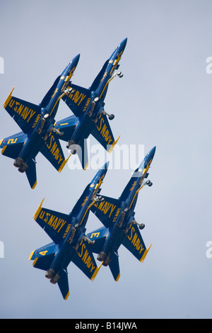 The elite U.S. Navy Blue Angels speed in formation at hundreds of miles per hour at the 2008 Joint Service Open - Stock Photo