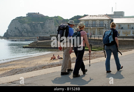 Coastal path walkers at Freshwater Bay seafront Isle of Wight England - Stock Photo