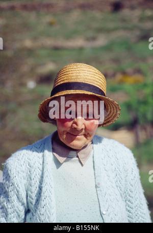 Portrait of an elderly woman wearing straw hat. Soria province. Castile Leon. Spain. - Stock Photo