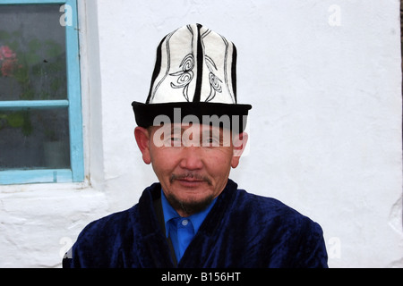 A Kyrgyzstani elderly man wearing a traditional hat. - Stock Photo