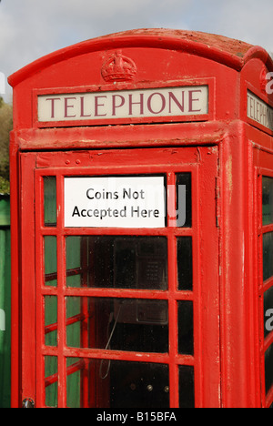 a telephone box in cornwall,england,uk that does not accept coins. - Stock Photo