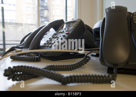 New telephones sit on a table in a newly constructed office building. - Stock Photo