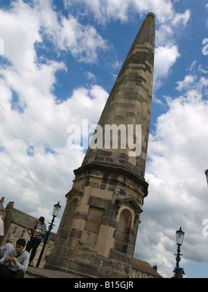 An octagonal sandstone obelisk rebuilt 1771 in the market place Richmond North Yorkshire UK - Stock Photo