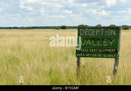 flat landscape with grass and sign Deception Valley CENTRAL KALAHARI GAME RESERVE Botswana Africa - Stock Photo