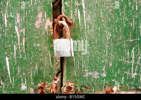 PADLOCK ON OLD GREEN MOROCCAN DOOR - Stock Photo