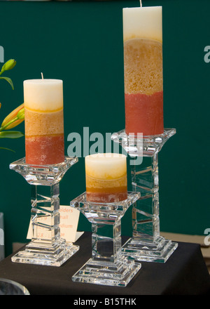 Large colored candles in glass holders - Stock Photo