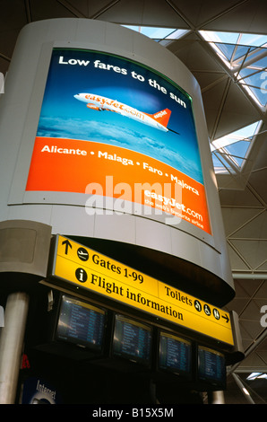 Nov 16, 2003 - Easyjet advertisement at London Stansted Airport in Great Britain. - Stock Photo